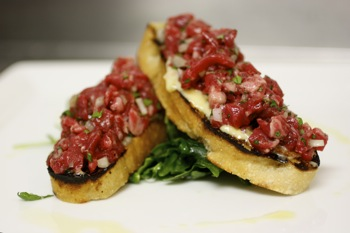 beef filet tartare on grilled ciabatta