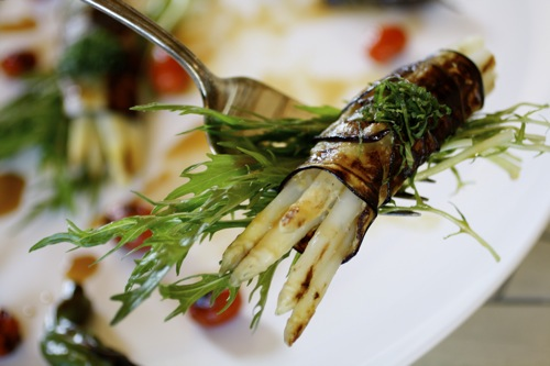 white asparagus wrapped in eggplant