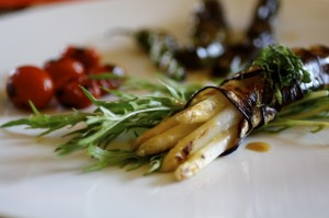 white asparagus wrapped in japanese eggplant