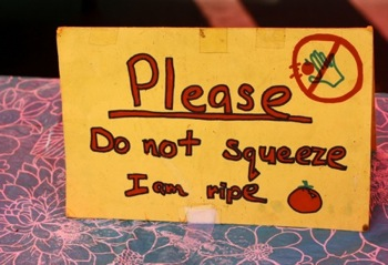 do not squeeze sign