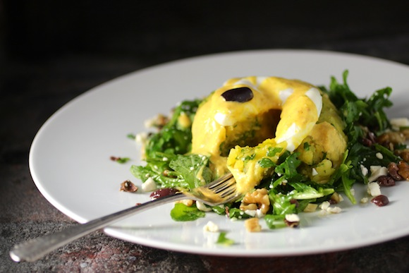 ensalada de papas a la huancaina (peruvian-style salad with potato cake, egg, and yellow chile)