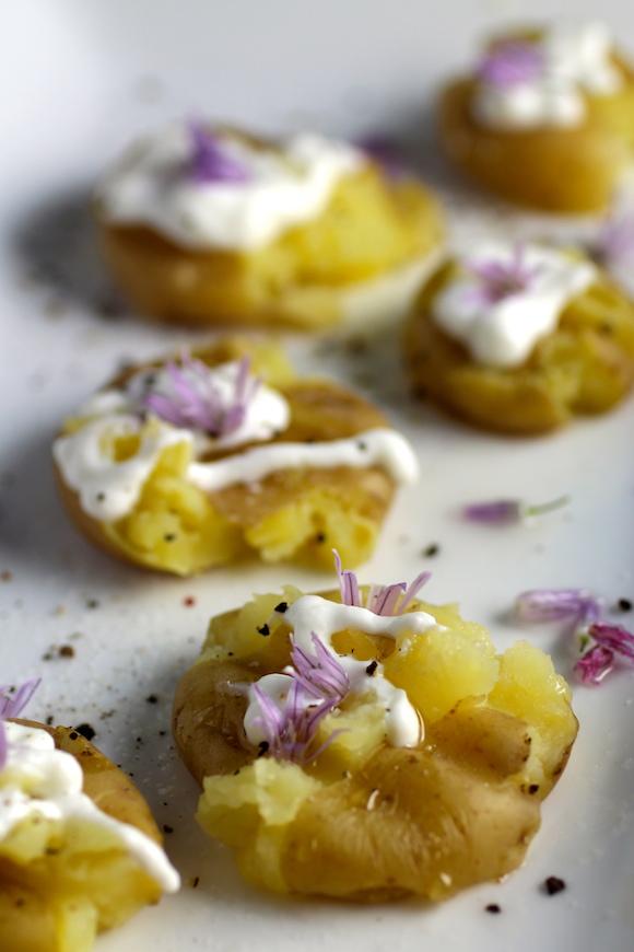 Precious Potato Bites ~ Truffle Oil, Sour Cream, Chive Blossoms