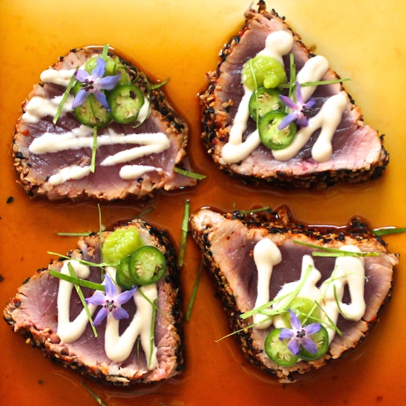 Togarashi Crusted Ahi over Ponzu with Roasted Garlic Tahini, Serrano, Kaffir Lime, Wasabi, Borage