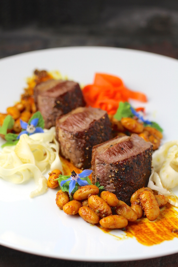 Silere Merino Lamb Loin Fillets Mustard Seed Sauce, Cannellini Beans Pickled Fennel, Carrot, Parsnip Cilantro, Mint, Borage