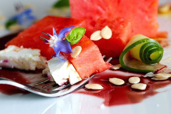 Watermelon Salad - Pomegranate Syrup, Feta, Cucumber, Red Onion, Borage, Cayenne, Olive Oil, Sprouted Watermelon Seeds, Basil