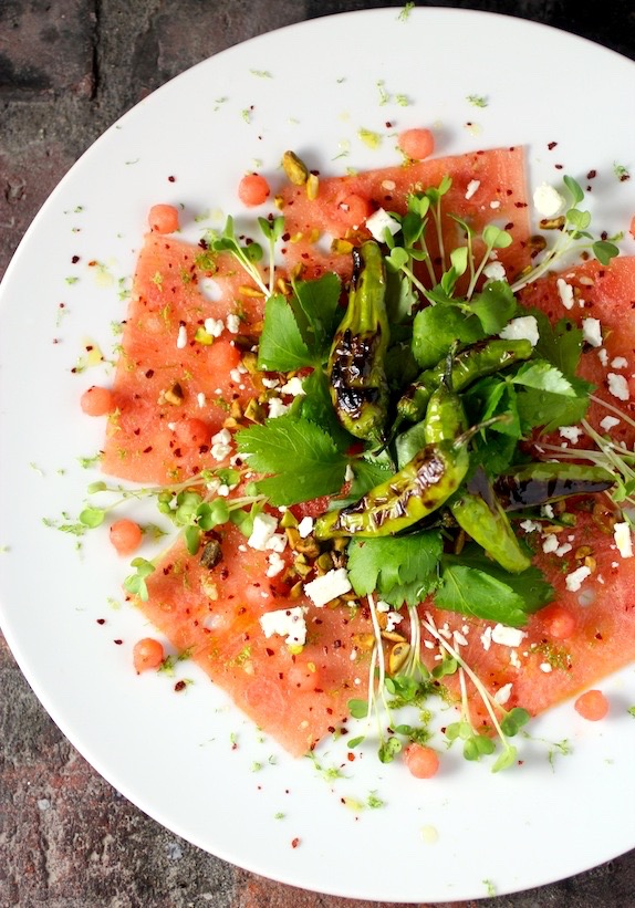 Watermelon Carpaccio Blistered Shishito Peppers, Mitsuba, Tiny Watermelon Balls Radish Sprouts, Pistachio, Feta, Lime Vinaigrette, Korean Red Chili Powder, Lime Zest