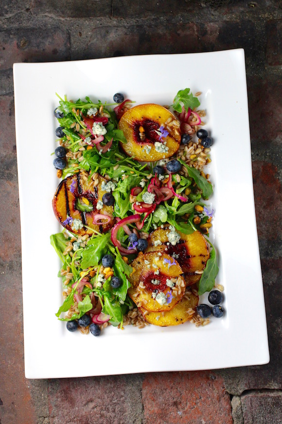 Grilled Peach Salad, Arugula, Farro, Blueberries, Red Onion, Bleu Cheese, Pistachio, Maple Bourbon Rosemary Dressing
