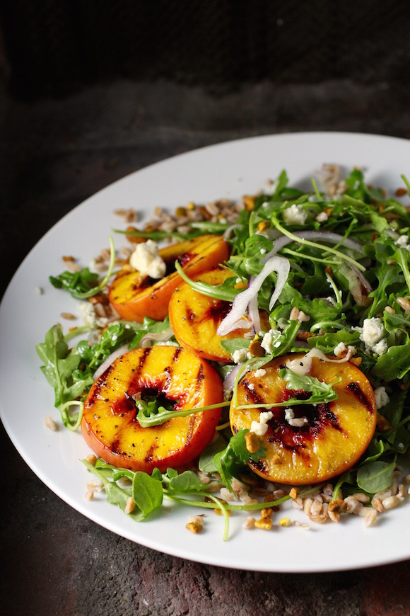 Grilled Peach Salad with Farro ~ Bourbon Grilled Peaches, Arugula, Blueberries, Red Onion, Bleu Cheese, Pistachio Nuts Maple Bourbon Rosemary Dressing