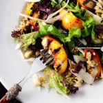 Grilled Nectarine Salad with Freekeh, Mixed Greens, Marcona Almonds, Parmesan, Fried Kalamata Olive Balsamic Reduction