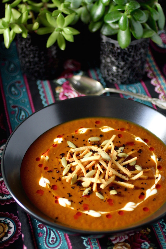 Sultry Pumpkin Soup - Southwest Flavors, Dressed To Kill  Pumpkin, Ancho Chile, Pear Tortilla Strips, Pumpkin Seeds, Chile de Arbol Flakes, Candied Orange Zest Cinnamon Crema, Chile Oil