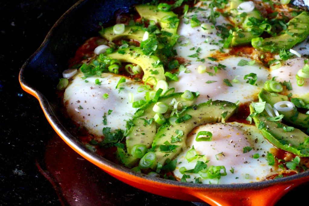 Southwest-Style Shakshuka (Eggs Cooked in Spiced Tomato Sauce) with Avocado, Epazote, Pinto Beans