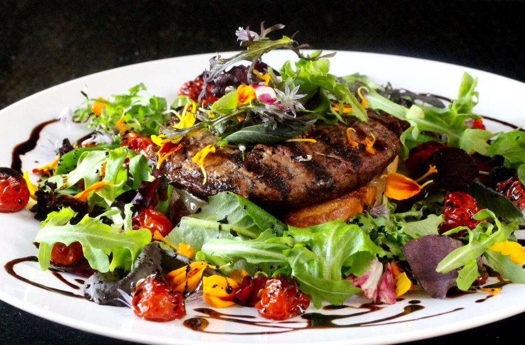 Colorful Open-Faced Swiss Burger with Flower Salad and Blistered Tomatoes