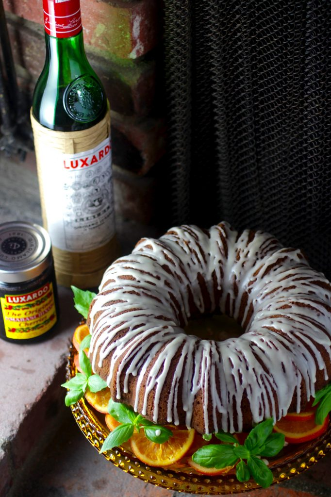 Olive Oil Bundt Cake with Luxardo Glaze, Cherries, and Candied Orange