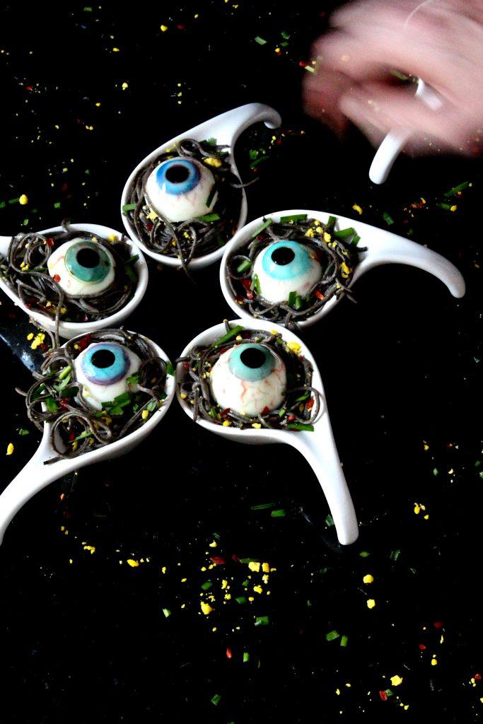 Deviled Eyes Nestled in Garlicky Black Bean Spaghetti Spoons