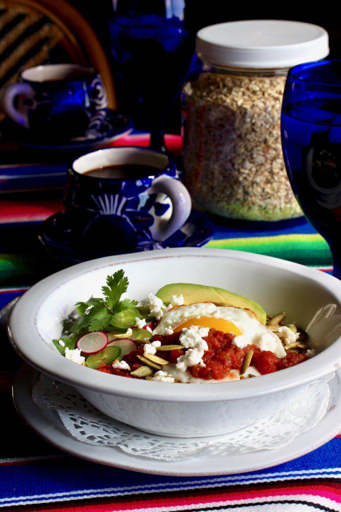 sunnyside oatmeal breakfast bowl with avocado, salsa roja, feta