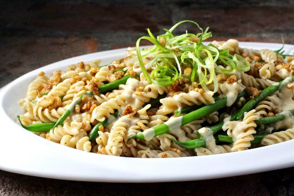 Brown Rice Fusilli and Green Beans Side Dish, Lemon Garlic Tahini Sauce, Crispy Rice Topping