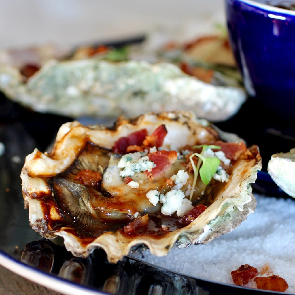 Grilled Oysters with BBQ Sauce and Bacon and Bleu Cheese